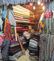 Fabric store vendor, asleep in his stall - probably tired from trying to find his shop in the maze of the Bazaar!!