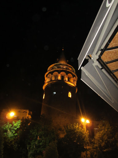 Galata Tower, all lit up at night.