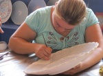 Hand-painting pottery.