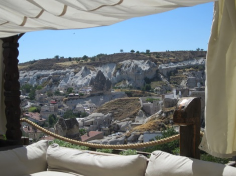 Looking out from the draped cloth covered terrace, a cool place to read or take advantage of the hotel's free wifi!
