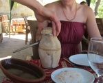A trying to open the clay pot - she succeeded in opening it, but it went poorly and went all over the place!