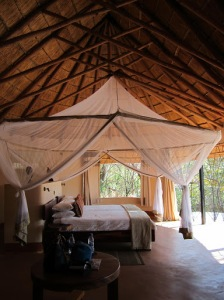 Our two single beds under the large ring of mosquito netting - very necessary as the room is largely open-air