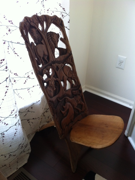 My hand-carved wood chair that I bought by Lake Malawi, from the guy who carved it.