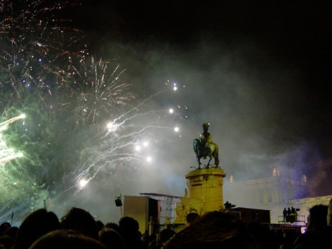 Fireworks over a statute in the square